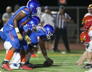 Kimball Jaguars offensive line ready for a play near the goal line during a varsity football game against Oakdale High At Don Nicholson Stadium in Tracy, CA.