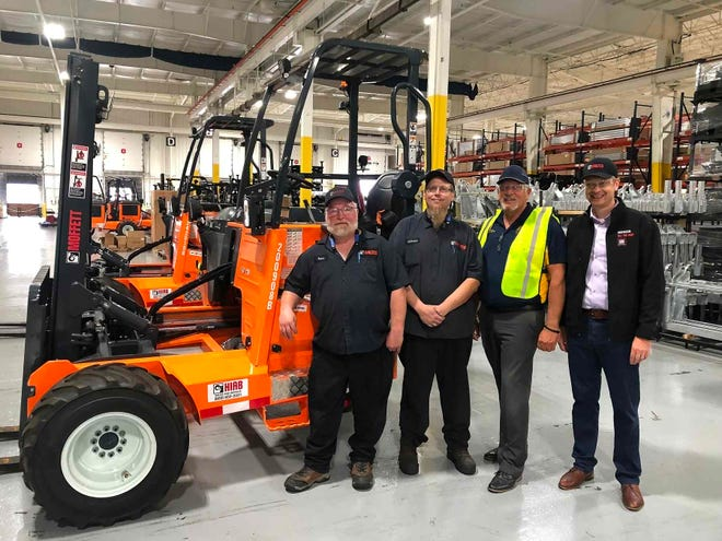 From left, long-term Waltco employees Gary Day and Zachary Weaver with Streetsboro Mayor Glenn Broska and Hiab Operations Manager Jarno Jli-Junnila celebrate the demand for new Moffett forklifts bringing 100 jobs to Streetsboro.
