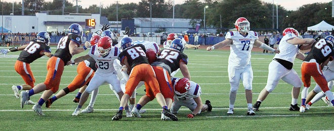 The Martinsville'sline gives their kicker plenty of time on an extra point attempt during Friday's Mid-State game at Whiteland.