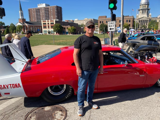 Wally Elder of St. Louis attends his first International Route 66 Mother Road Festival in downtown Springfield on Saturday. Elder showed off his custom-built 1969 Dodge Daytona at the intersection of Fifth Street and Capitol Avenue.