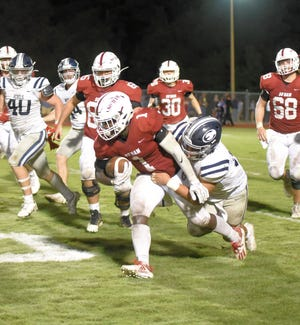 South Effingham's Cameron Edwards (1) gets a first down on a 10-yard run late in the third quarter against Effingham County in Guyton. Effingham County won 34-0 on Sept. 24.
