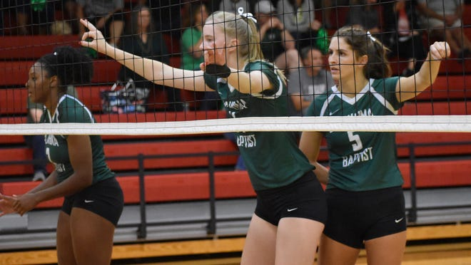 Oklahoma Baptist's Avery Helmuth (14) and Taryn Weber (5) await a serve during the Bison's volleyball match against Northwestern Oklahoma State last Friday.
