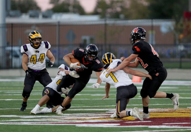 Ipswich running back Carson Gohl tries to escape a tackle from Herreid/Selby Area linebacker Trevor Sayler in Friday's game at Dacotah Bank Stadium. American News photo by Jenna Ortiz, taken 09/24/2021.