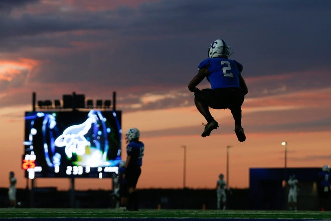 Junction City junior TJ Jones (2) warms up his legs before a kickoff in the first half of last Friday's game against Washburn Rural.