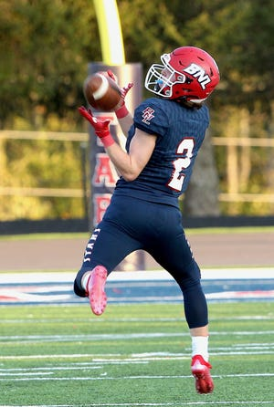 Bedford North Lawrence running back/receiver Dylan Nikirk (2) catches a pass which he will turn into a first half touchdown.
