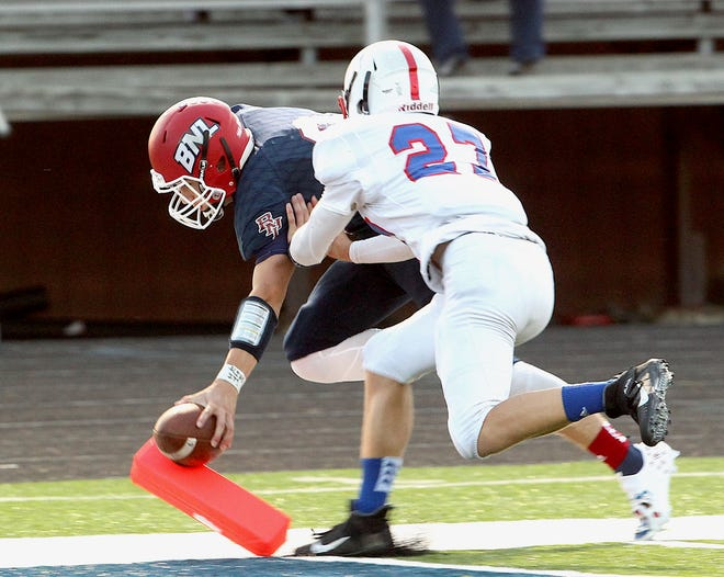 Bedford North Lawrence quarterback Memphis Louden (9) is ruled out of bounds just before reaching the end zone to set up a touchdown for the Stars Friday night in a 47-14 win over Jennings County.