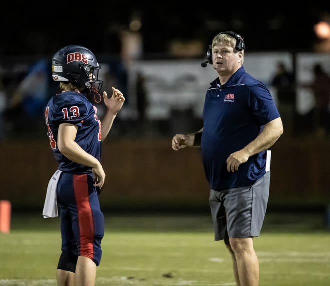 Bozeman coach Jason Griffin talks with quarterback Peyton Gay during the game. Bozeman hosted Wewahitchka under the lights for Friday night football Friday, September 24, 2021.