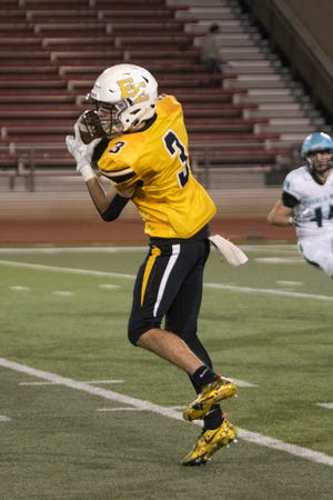 Pueblo East High School's Brandon Atencio Hauls in a pass during the matchup with Pueblo West at the Colorado State University Pueblo ThunderBowl on Friday September 24, 2021.