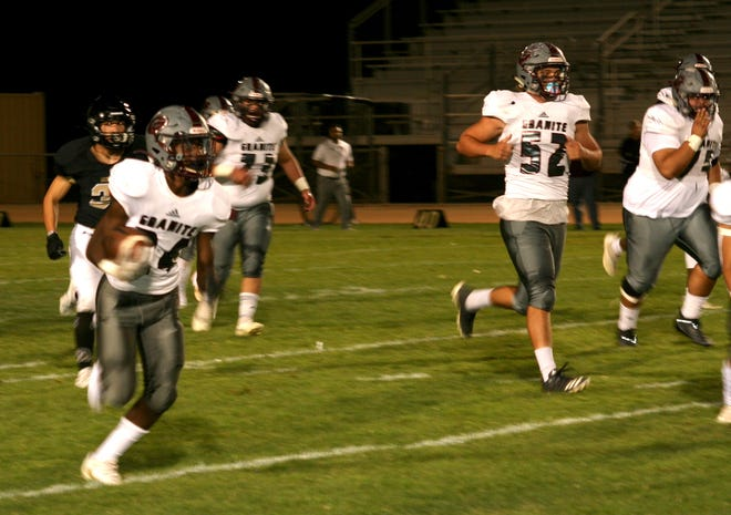 Granite Hills' Kameron Smith carries the ball up field against Hesperia at Scorpion Stadium on Sept. 24, 2021.