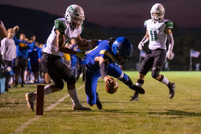 Serrano's quarterback Payton Cornell reaches in for a touchdown against Victor Valley during the first half at Snowline Stadium, in Phelan, on Sept. 24, 2021.