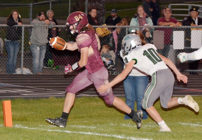 Milbank Area's Carter Bowsher find the end zone on a touchdown reception ahead of Clark-Willow Lake's Elliot Bratland during their high school football game Friday night in Milbank. The host Bulldogs celebrated their homecoming with a 34-13 win.