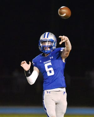 Danvers quarterback Travis Voisine unleashed a pass against visiting Reading on Sept. 24. But after losing to the Rockets, the Falcons bounced back to trounce Winthrop last Friday night, 42-0.
