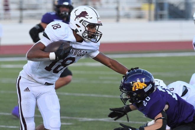 Brownwood receiver Jason Jackson (18) tries to break a tackle during Friday's game against Wylie at Hugh Sandifer Stadium on Sept. 24, 2021. The Lions couldn't overcome a 42-0 deficit in the 49-21 loss.