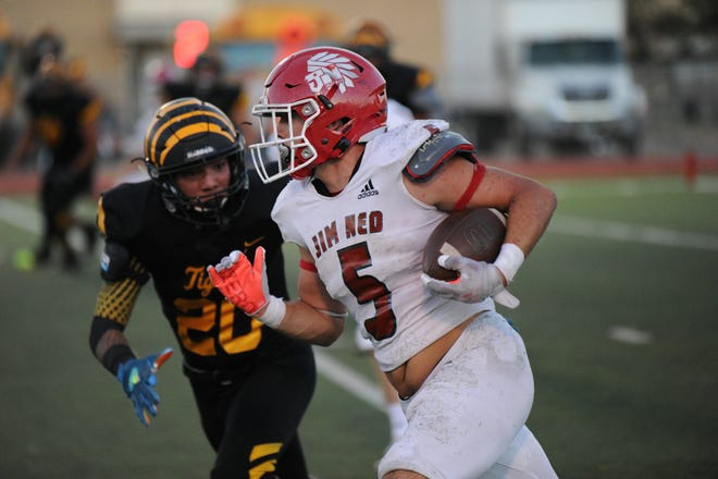 Xavier Wishert surges past a defender Friday in Jim Ned's 22-15 win over Snyder. Wishert ran for 155 yards and a touchdown.