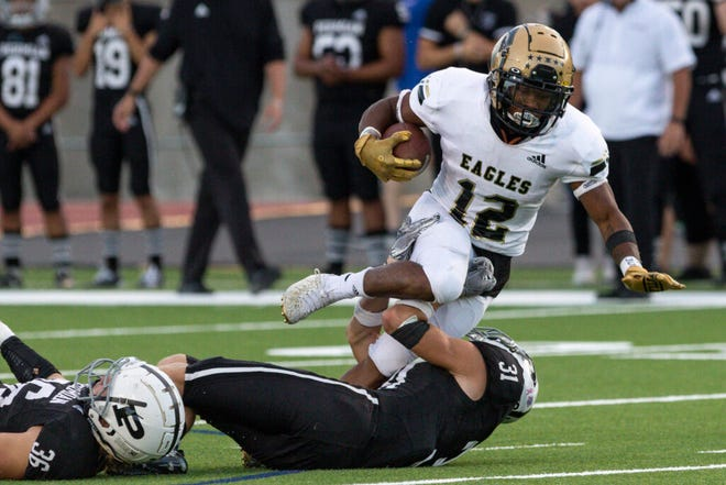 Permian's Bryce Woody (31) brings down Abilene High running back Da'King Thomas (12) in the first half in Odessa.