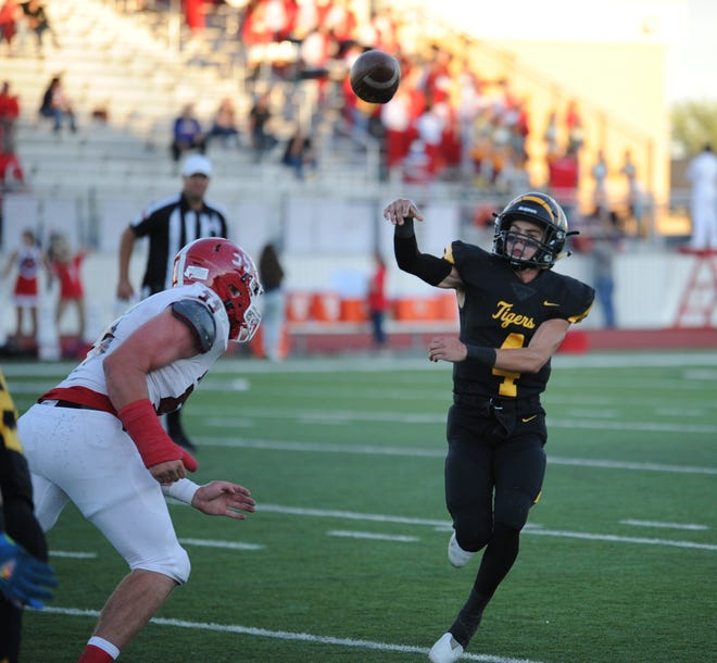 Snyder quarterback Hunter Stewart throws the ball away  in the Tigers' game against Jim Ned on Friday, Sept. 24, 2021.