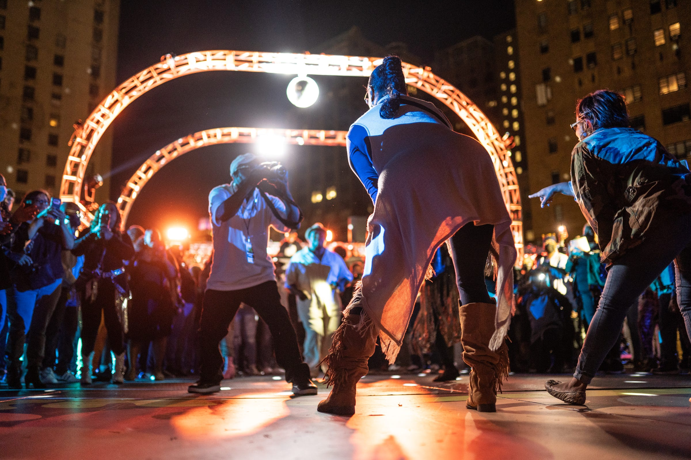 """People get their 30 seconds to shine while performing during a dance line as part of """"The Scene with Nat Morris and Friends"""" as part of the DLECTRICITY event at Beacon Park in downtown Detroit on September 24, 2021. The event featured former dancers from Detroit's historic daily dance show that aired on WGPR TV, the first African-American owned and operated television station licensed by the FCC in The United States from 1975-1987, taking part in an open dance floor. The Scene looked to attempt Detroit's longest dance line giving each dancer 30 seconds to keep it moving."""