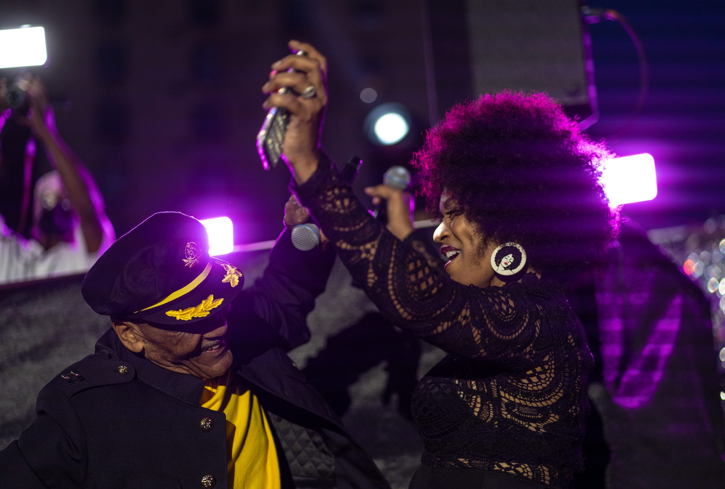 """Nat Morris, executive producer and host of Detroit's historic daily dance show, """"The Scene"""", and LaWanda Gray-Anner dance together on stage while emceeing during """"The Scene with Nat Morris and Friends"""" as part of the DLECTRICITY event at Beacon Park in downtown Detroit on September 24, 2021. The event featured former dancers from Detroit's historic daily dance show that aired on WGPR TV, the first African-American owned and operated television station licensed by the FCC in The United States from 1975-1987, taking part in an open dance floor. The Scene looked to attempt Detroit's longest dance line giving each dancer 30 seconds to keep it moving."""