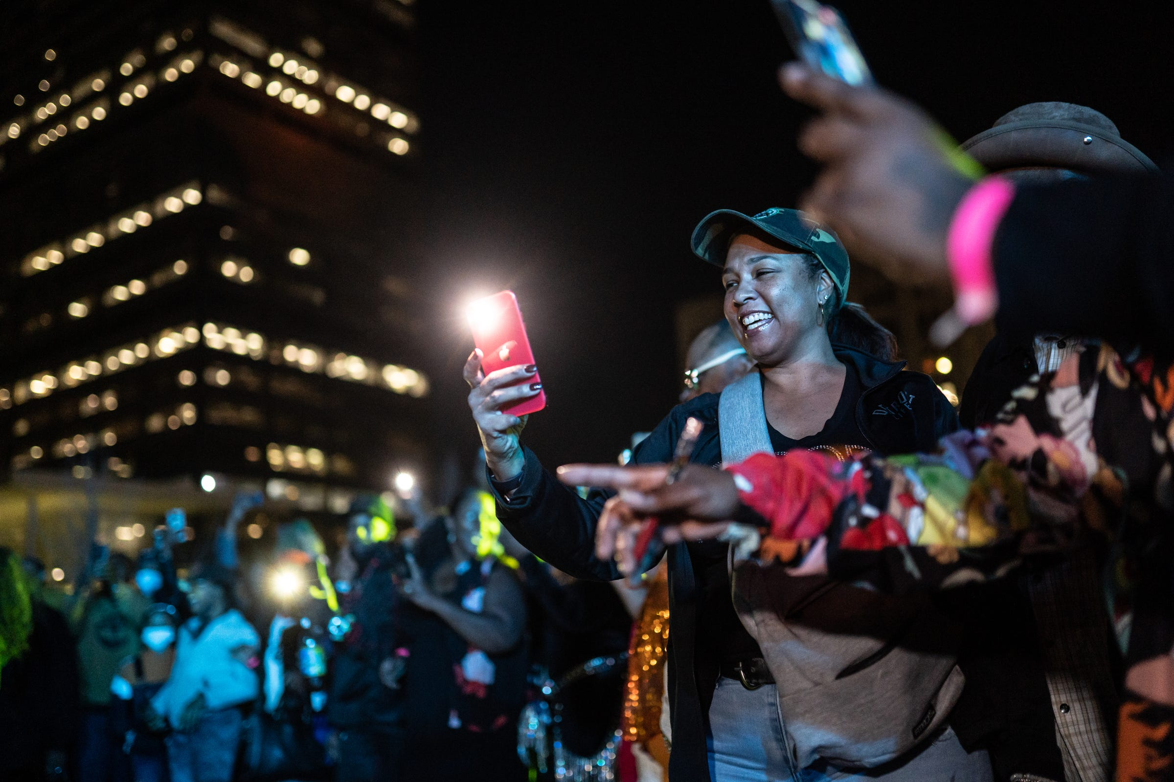 """The crowd surrounds as people get their 30 seconds to shine while performing during a dance line as part of """"The Scene with Nat Morris and Friends"""" as part of the DLECTRICITY event at Beacon Park in downtown Detroit on September 24, 2021. The event featured former dancers from Detroit's historic daily dance show that aired on WGPR TV, the first African-American owned and operated television station licensed by the FCC in The United States from 1975-1987, taking part in an open dance floor. The Scene looked to attempt Detroit's longest dance line giving each dancer 30 seconds to keep it moving."""