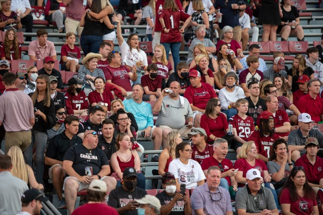 Fans sit and watch before the start of South Carolina vs. Kentucky at Williams-Brice Stadium in Columbia, South Carolina on Sept. 25, 2021.