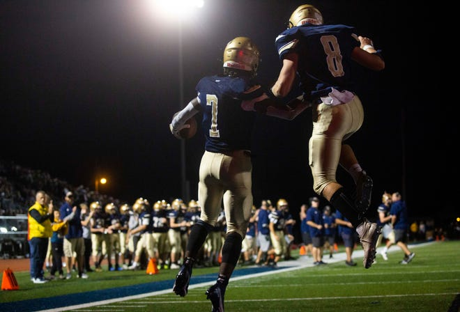 Lancaster running back Nasir Robinson and quarterback Trace Van Gundy celebrate a touchdown during the Golden Gales' 35-20 win over Central Crossing last week. With the win, Lancaster moved up in the playoff rankings from No. 15 to No. 9 in Division I, Region 3. The top 16 teams in each region qualify for the playoffs.