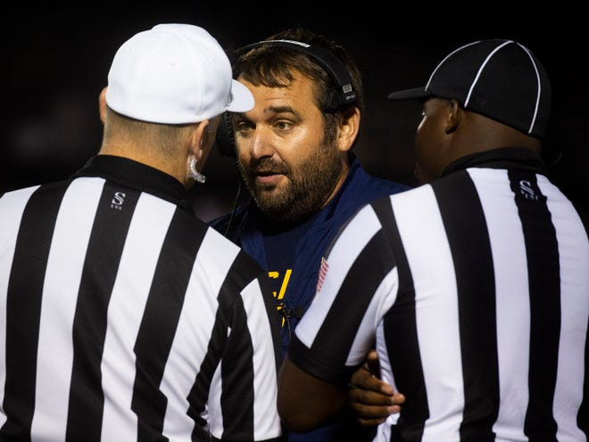 Lancaster football coach Bryan Schoonover talks with officials during the Golden Gales' 35-20 win over on Central Crossing last week. On Friday, Lancaster travel to Groveport, the school Schoonover was the head coach at for seven years before coming to Lancaster this season.