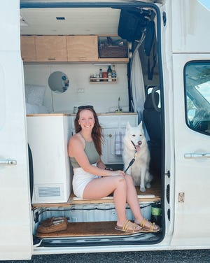 Grand Ledge native Maddie Burman with Daisy, her Siberian Husky, has been traveling the country and living in a renovated van since January.