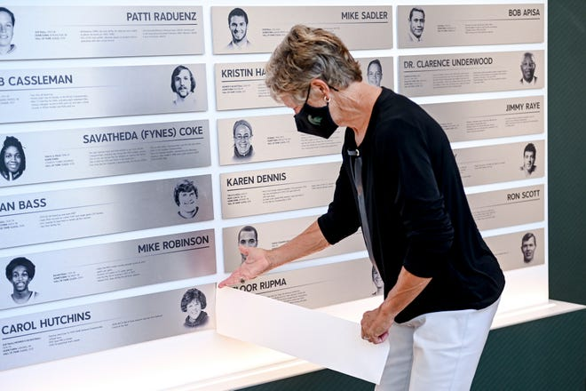 Carol Hutchins, Softball/Women's Basketball (1976-79), unveils her plaque as an inductee to Michigan State University's 2021 Hall of Fame class during an induction ceremony on Friday, Sept. 24, 2021, at the Clara Bell Smith Center on the MSU campus in East Lansing.