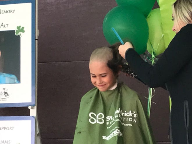 Gavin Lamb, 12, a seventh-grader at Shelby Middle School, allowed hair stylist Janelle Blake of Roots salon in Mansfield to shave his head for the sixth time, all to support pediatric cancer research.
