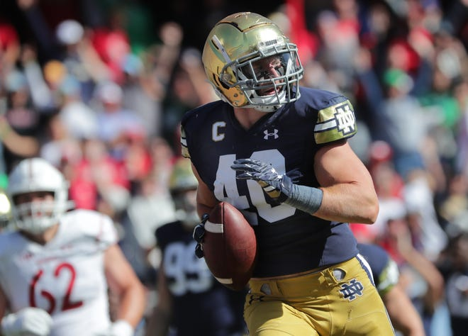 Notre Dame linebacker Drew White (40) returns an interception 40 yards for a  touchdown during the fourth quarter of their game Saturday, September 25, 2021 at Soldier Field in Chicago, Ill. Notre Dame beat Wisconsin 41-13.