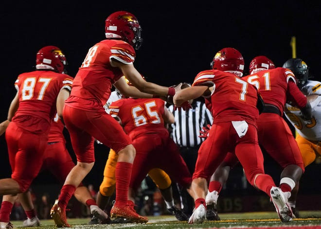 Deep in their own territory Chaparral quarterback Brayten Silbor (18) hands off the ball to running back Grady Hickey (7) and he took it 89 yards for a touchdown during the fourth quarter of their game with Saguaro Sept, 24, 2021 in Scottsdale.