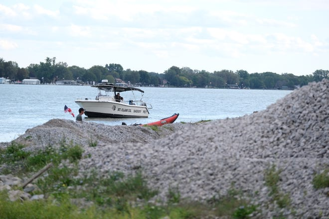 A St. Clair County Sheriff boat searches the St. Clair River where it meets the Belle River Saturday, Sept. 25, 2021, in Marine City.