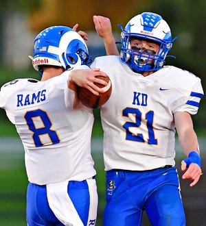 Kennard-Dale's Jacob Copenhaver, left, and Steven Lukes celebrate a touchdown scored by Lukes during football action at York Suburban Senior High School in Spring Garden Township, Friday, Sept. 24, 2021. Kennard-Dale would win the game 42-10. Dawn J. Sagert photo