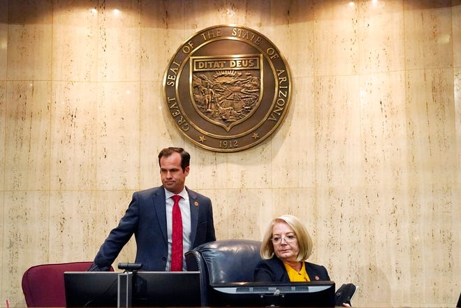 Arizona Senate President Karen Fann, R-Prescott, right, is joined by Sen. Warren Petersen, R-Gilbert, prior to the Arizona Senate Republican hearing on the review findings of the 2020 election results in Maricopa County at the Arizona Capitol, Friday, Sept. 24, 2021, in Phoenix. The final report of the election review found that President Joe Biden did indeed win the 2020 presidential contest. (AP Photo/Ross D. Franklin)