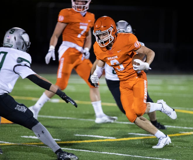 Sprague's Blaise Pearson (3) carries the ball during the second quarter of the game against the Summit Storm at Sprague High School in Salem on Sept. 24.