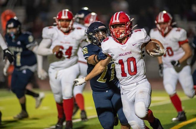 Ashton Buzzeta, #10, runs passed an Everett Alvarez High School player inside the Jim Revis Field in Salinas, Calif., on Friday, Sept. 24, 2021.