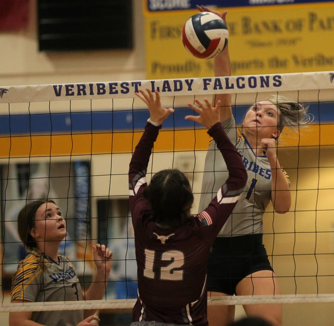 Veribest High School's Cora Blackwell, 11, goes up for a shot as Bronte's Maelynn  Williams defends the net in a District 7-2A match at the Veribest gym on Saturday, Sept. 25, 2021.