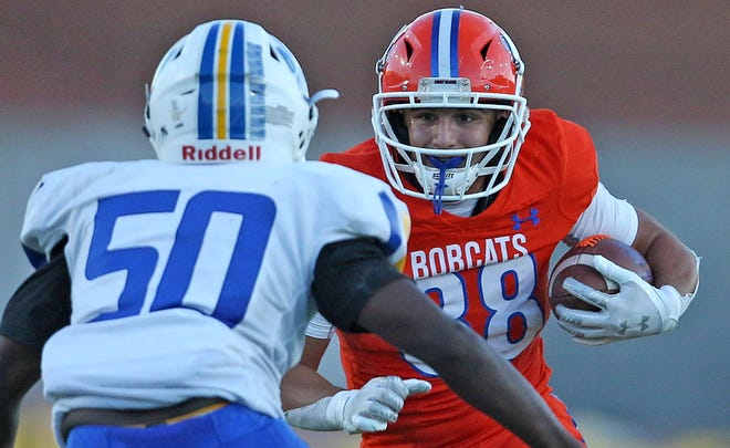 Samuel Navarrette, right, rushes the ball for Central during a game against Frenship on Friday, Sept. 24, 2021.