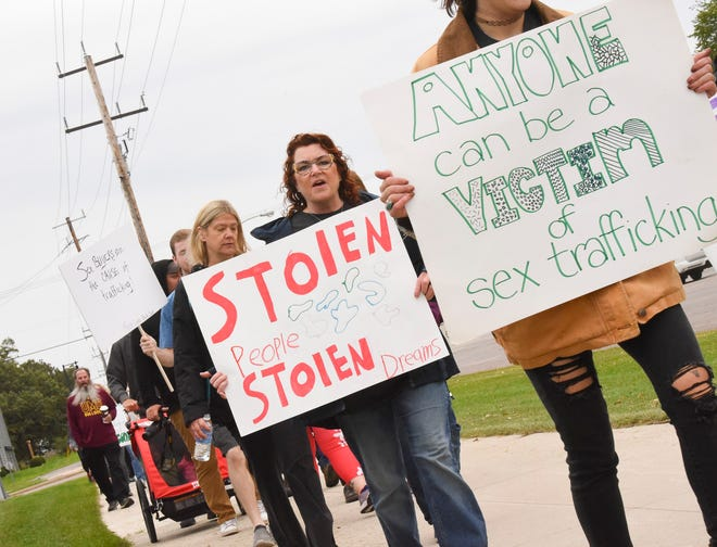Participants in the Walk Together-Uniting Against Sex Trafficking event make their way around Rivers Edge Park Saturday, Sept. 25, 2021, in Waite Park.