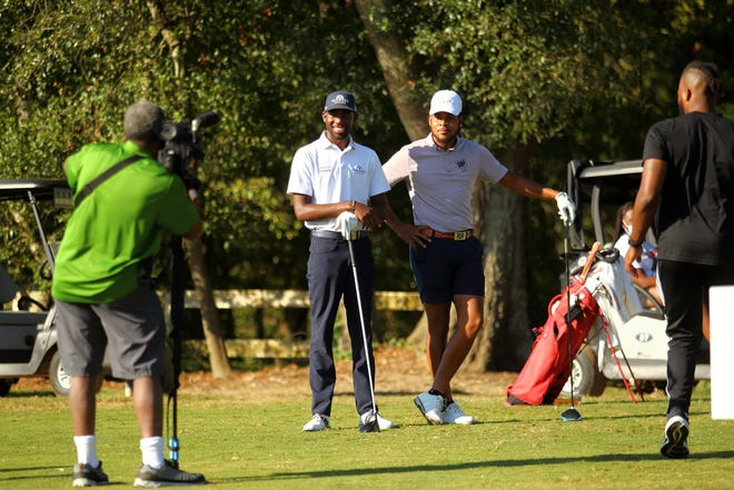 Kamaiu Johnson (center) held his inaugural MY MY Charity Golf Tournament at  Hilaman Golf Course on Sept. 25, 2021.