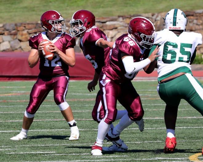Valhalla High School football quarterback Michael Dawson looks for an open man as they play Woodlands High School, Sept. 25, 2021 at Valhalla High School.
