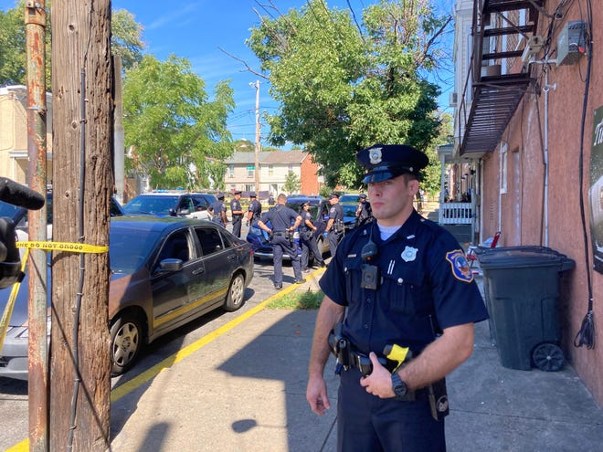 Wilmington police investigate in the 400 block of N. Monroe St. after a shooting at 12:52 p.m. on Sept. 25, 2021. A 29-year-old man was taken to the hospital in critical condition, police reported.