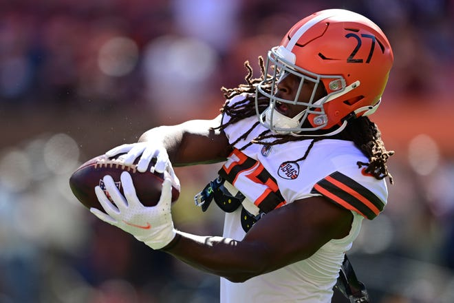 Cleveland Browns running back Kareem Hunt warms-up before an NFL football game against the Chicago Bears, Sunday, Sept. 26, 2021, in Cleveland. (AP Photo/David Dermer)