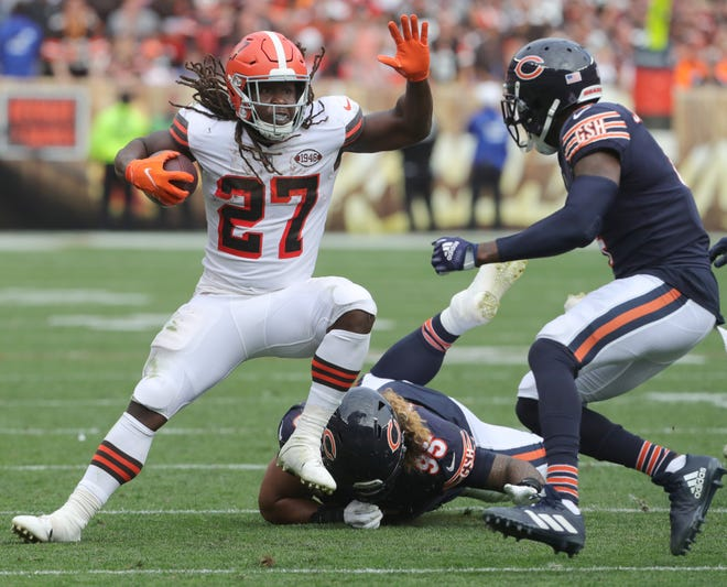 Cleveland Browns running back Kareem Hunt gets past Chicago Bears' Khyiris Tonga on Sunday, Sept. 26, 2021 in Cleveland, Ohio, at FirstEnergy Stadium. The Browns won the game 26-6.  [Phil Masturzo/ Beacon Journal]