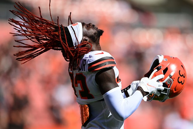Cleveland Browns defensive back Ronnie Harrison puts on his helmet before an NFL football game against the Chicago Bears, Sunday, Sept. 26, 2021, in Cleveland. (AP Photo/David Dermer)