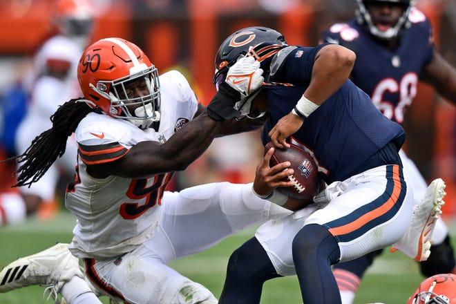 Browns defensive end Jadeveon Clowney, left, sacks Bears quarterback Justin Fields during the second half Sunday, Sept. 26, 2021, in Cleveland. (AP Photo/David Richard)