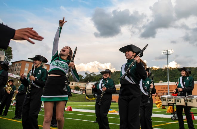Members of the Riverside High School band celebrate during their performance in the 43rd annual Beaver County Invitational Marching Band Festival Saturday at Reeves Stadium at Geneva College.
