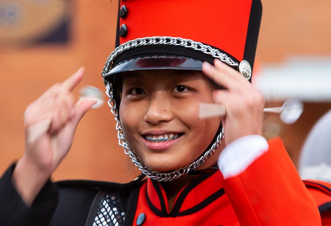 Beaver Falls High School xylophone player Lydia Chen adjusts her hat before the Tigers' band perform at the 43rd annual Beaver County Invitational Marching Band Festival Saturday at Reeves Stadium at Geneva College.