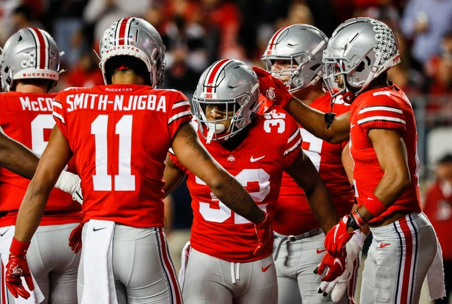 Ohio State Buckeyes running back TreVeyon Henderson (32) celebrates with teammates after scoring a touchdown during the first quarter of a NCAA Division I football game between the Ohio State Buckeyes and the Akron Zips on Saturday, Sept. 25, 2021 at Ohio Stadium in Columbus, Ohio.