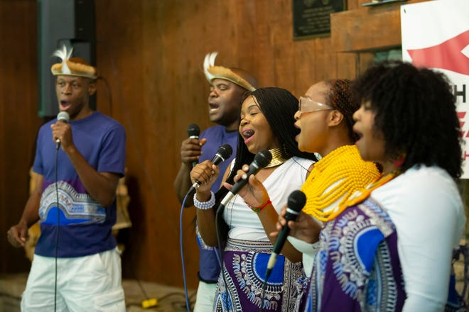"""A group performs traditional African songs during the Food 4 a Cause event for Drill 4 Life at the Highbanks Metro Park Sunday. """"Everyone has a right to clean water,"""" co-founder Simba Muswela said."""